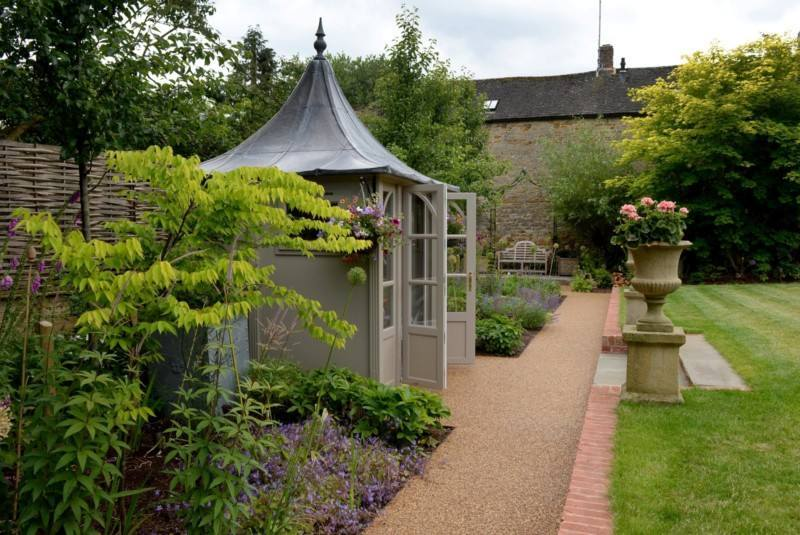 HSP Summerhouse with Resin Bound path in terraced Cotwsold garden