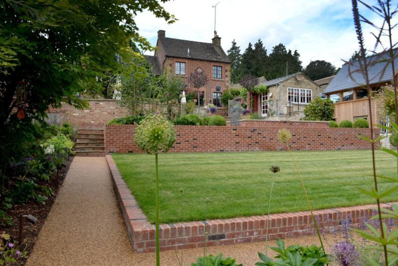 Terraced Cotswold garden with resin bound paths