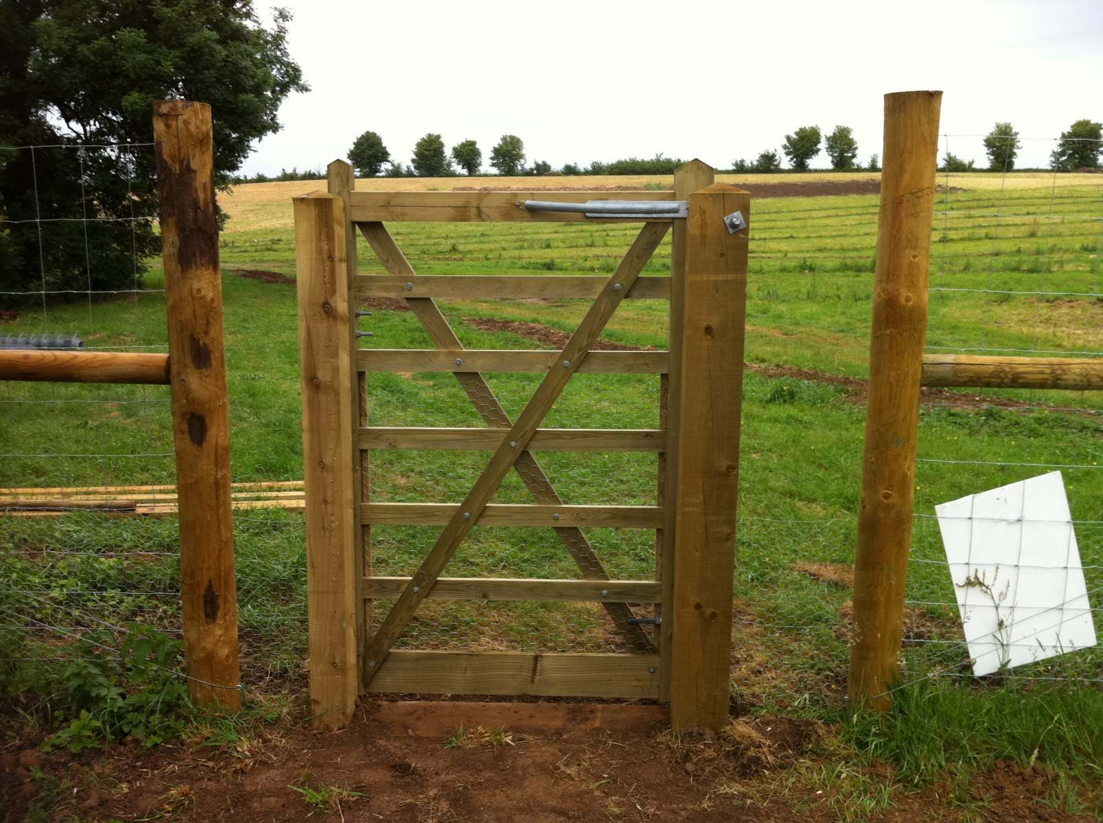 Timber_gate_in_deer_proof_fence_rabbit_netting_