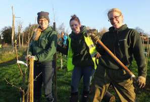 Members of staff get ready to create a forest school