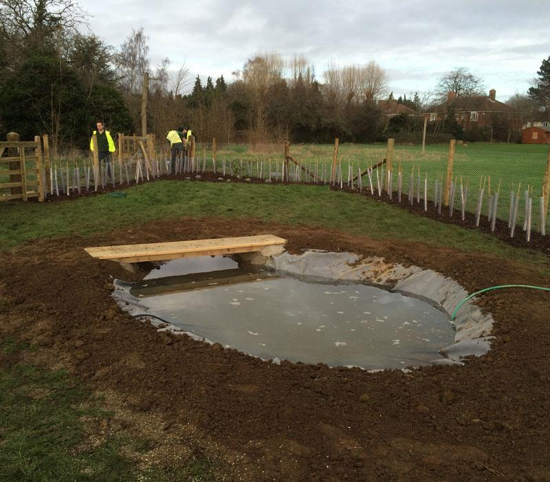 The new wildlife pond that is being filled for Rose Hill Primary School's new forest school